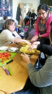 Learners preparing food on the Healthy Cooking training course