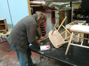 Learner upcycling a chair